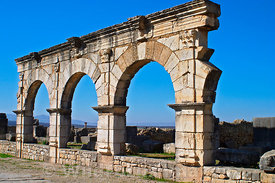 Arched facade on the Decumanus Maximus, Volubilis, Morocco; Landscape