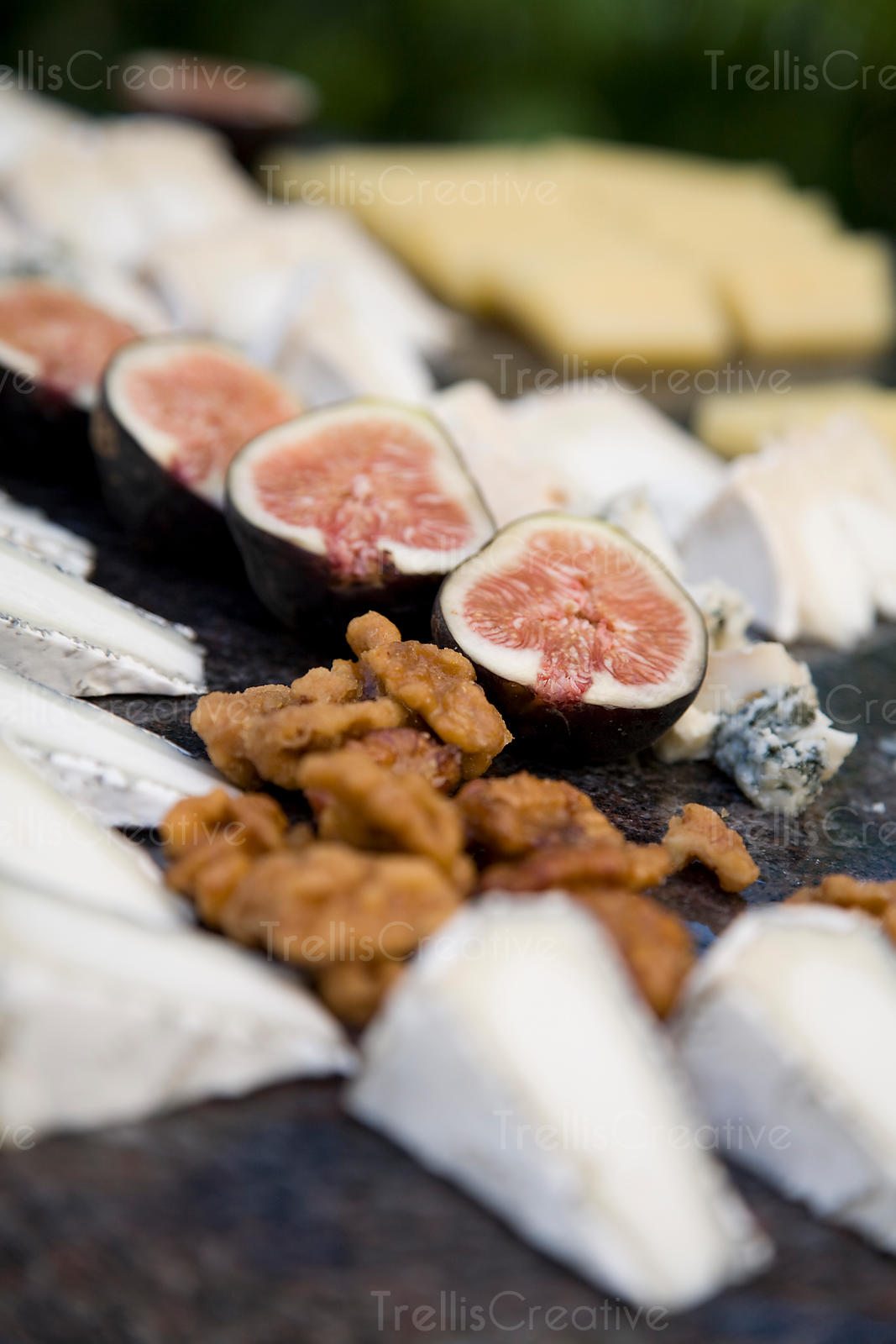 A platter of figs, nuts and cheese