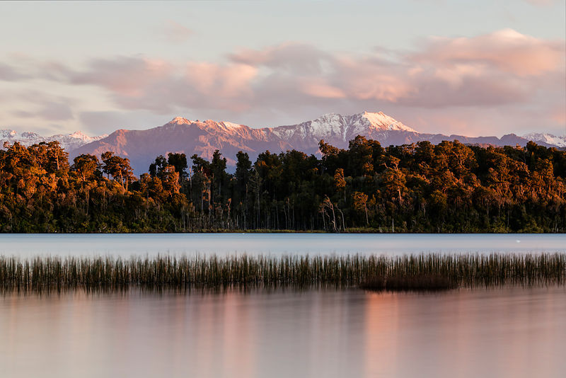 Soft colours of Sunset Over Lake Mahinapua Near Hokitika, West Coast, South Westland, New Zealand