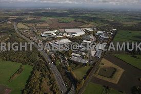 Runcorn high level aerial photograph of Whitehouse Industrial Estate showing the M56 motorway running towards the east and Ma...