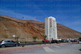Apartment block under construction below cliffs near El Morro headland, Arica, Region XV, Chile