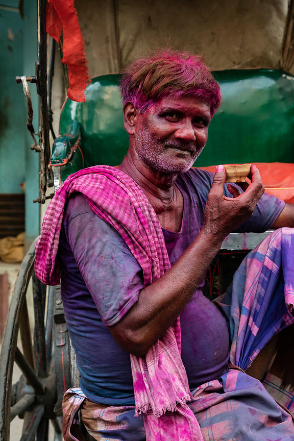 Rickshaw Driver Stained with Holi Colour