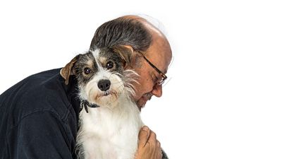 Man Hugging Terrier Crossbreed Dog