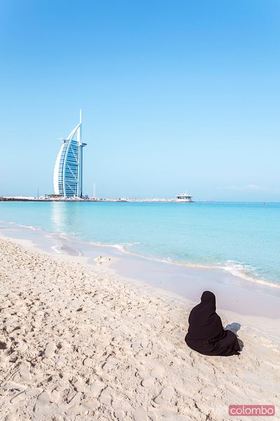 Arab woman looking at Burj Al Arab, Dubai