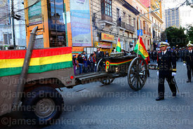 A navy officer escorts the remains of Eduardo Abaroa as they are carried on a gun carriage to Plaza Avaroa, La Paz, Bolivia
