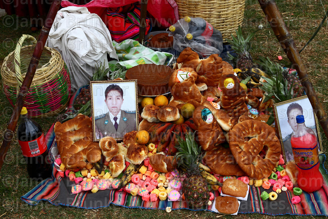 Detail of shrine with bread and fruit offerings for deceased policeman in cemetery, Todos Santos festival, La Paz, Bolivia