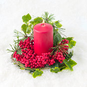 Christmas decoration with candlelight and cones on snow