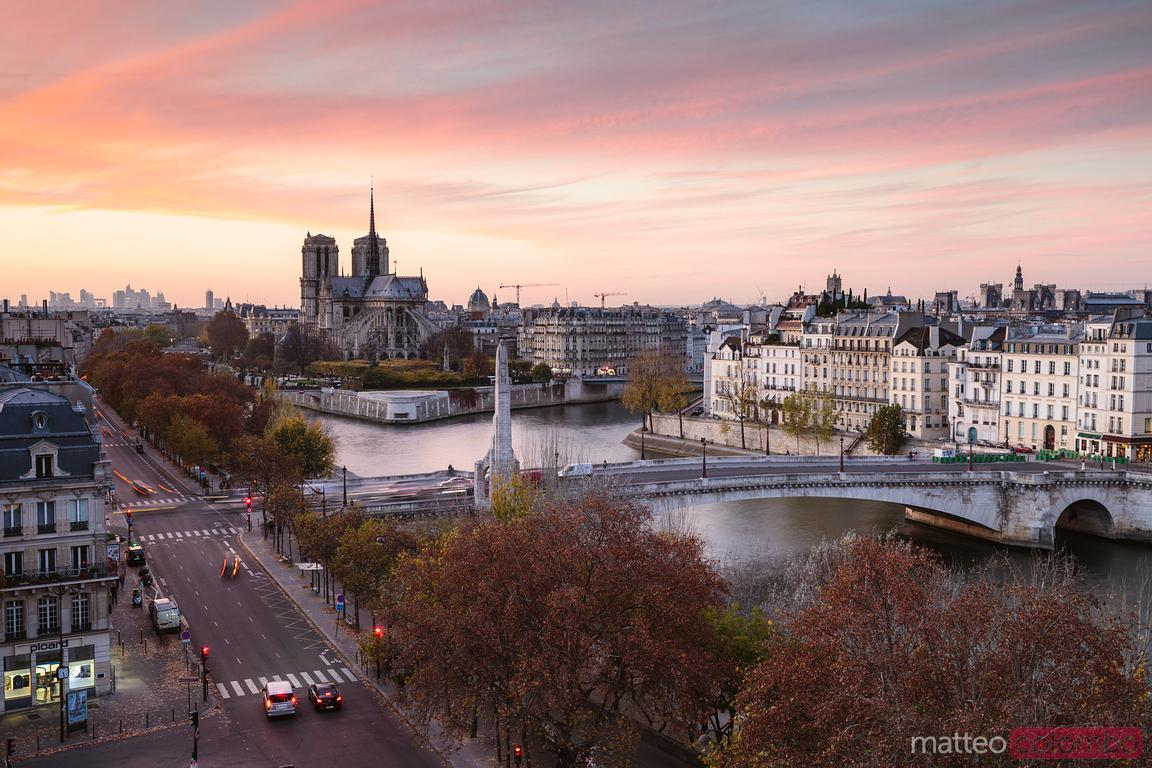 Awesome sunset on Paris and Notre Dame cathedral, France