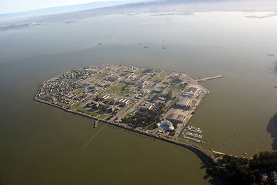 Aerial view of Treasure Island, an artificial island created on reclaimed land dredged from the Bay. San Francisco, California