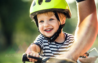 Portrait of smiling toddler wearing cycling helmet