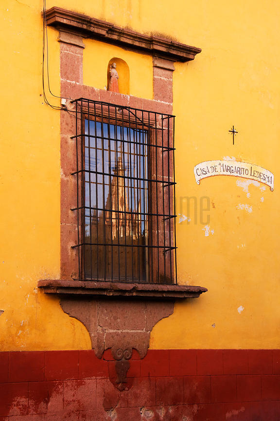 Parroquia Reflected in a Window