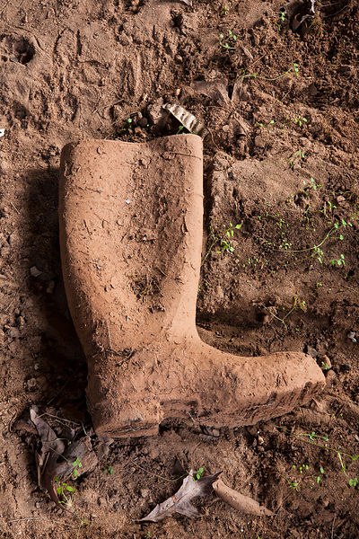 Mud covered boot in an outbuilding of an old textile mill