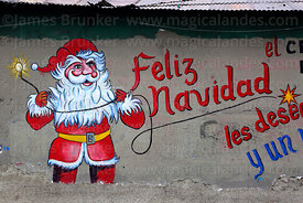 Father Christmas mural on wall of the offices of an electricians and electrical workers cooperative, La Paz, Bolivia