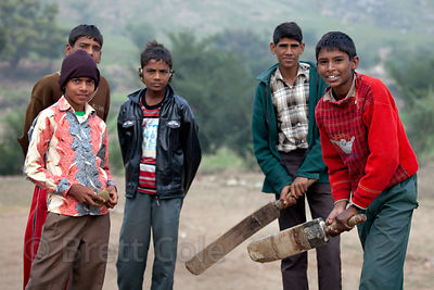 Boys playing cricket in the rural village of Kharekhari, Rajasthan, India