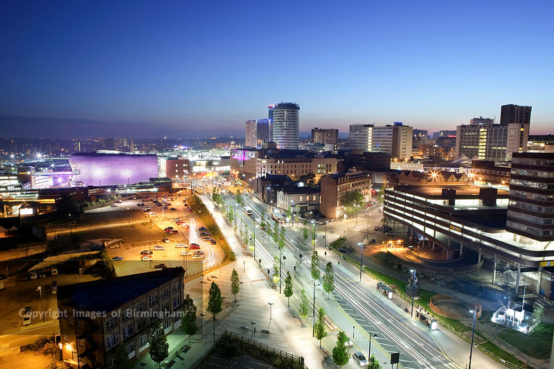 Eastside area of Birmingham.  View from Masshouse development to the Selfridges, Rotunda and Bullring buildings. Night cityscape.