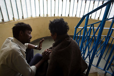 India - Delhi - Khushi Ram, a worker for Aashray Adhikar Abhiyan counsels Kulbahadur a former drug addict that has been treat...