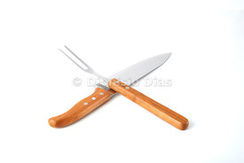 Superimposed x shaped knife and fork, isolated white background