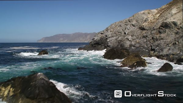 Past Cliffs and Surf-splashed Rocks Along the Catalina Coastline.