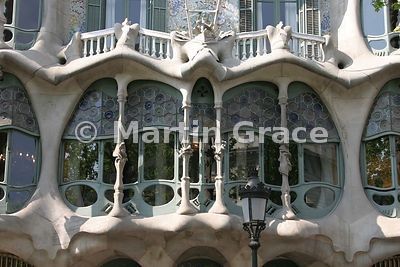 Facade of Gaudi-designed Casa Batllo apartment building in Barcelona showing Montjuic sandstone columns