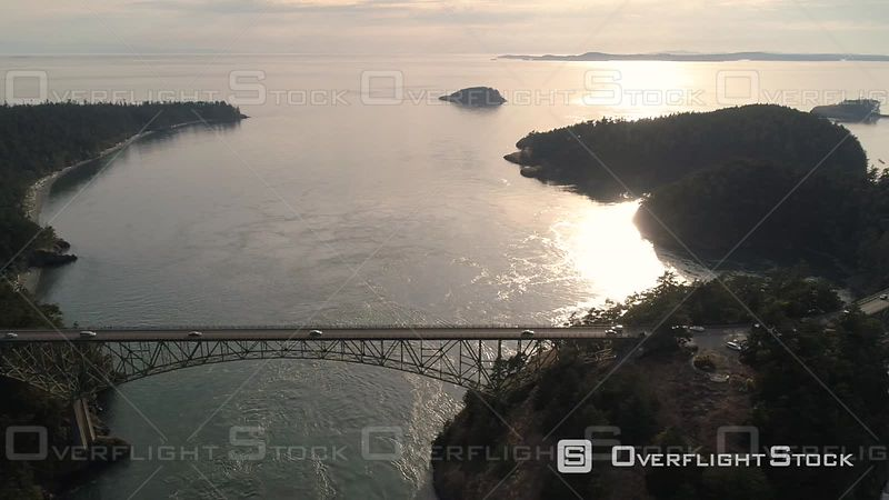 Washington State helicopter view of Deception Pass bridge on the Puget Sound coastline.