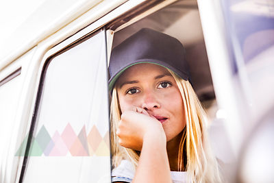 Young woman looking out of window of a van