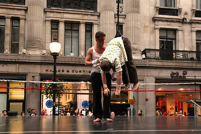 Man Hanging on a Rope  on Stage in London Street