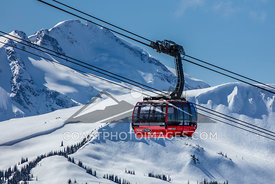 March 28, 2016: Whistler BC. The peak2peak gondola as it approaches Blackcomb from Whistler Mountain on a sunny winter day. Photo by Mitch Winton - coastphoto.com