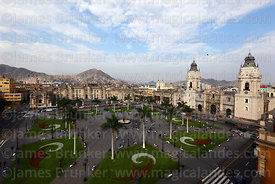 View of Plaza de Armas, government palace and cathedral, Cerro San Cristobal in background, Lima, Peru