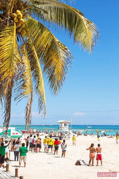 Crowded tropical beach on the caribbean sea, Mexico