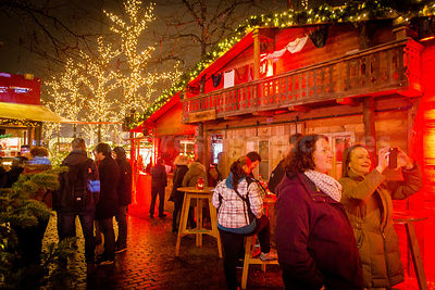 Visitors enjoying the Santa Pauli Christmas Market in Hamburg