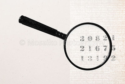 magnifying glass and vintage numbers