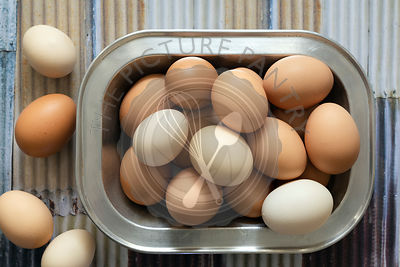A collection of brown and white eggs.