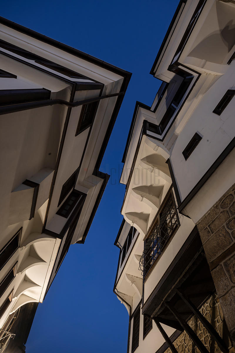 Looking up at Buildings in a Narrow Street at Dawn