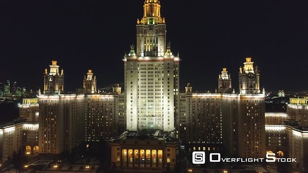 Moscow State University and Illuminated Moscow Skyline at Winter Night. Russia. Aerial View. Drone is Flying Upward and Backw...
