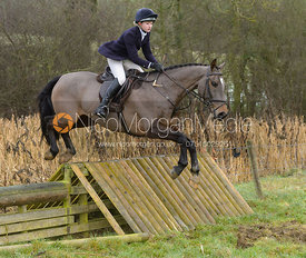 Amelia Leeming jumping a hunt jump at Peakes - The Fitzwilliam Hunt visit the Cottesmore at Burrough House