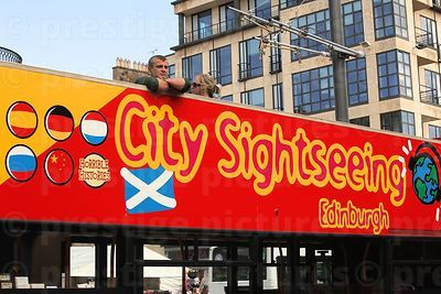 Man Stares from the Top Deck of a City Sightseeing Bus in Edinburgh
