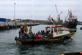 Statue of St Paul on fishing boat at start of procession around port, St Peter and St Paul festival, Arica, Chile