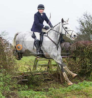 Charlotte Barnes jumping near the new Jubilee Covert - Cottesmore Hunt at Deane Bank Farm 4/12/12