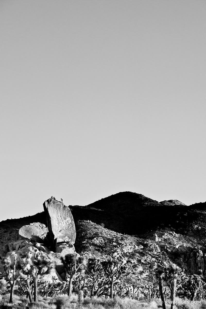 ROCK CLIMBING JOSHUA TREE NATIONAL PARK BLACK AND WHITE VERTICAL