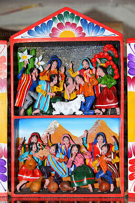 Painted wooden wall decoration with indigenous nativity scene for sale in Christmas market, La Paz, Bolivia