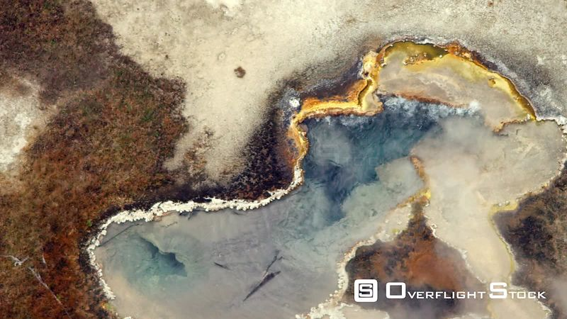A colorful thermal pool gives off steam in the cool atumn air in the lower geyser basin of Yellowstone National Park
