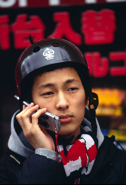 A man talks into his mobile telephone, Tokyo, Japan