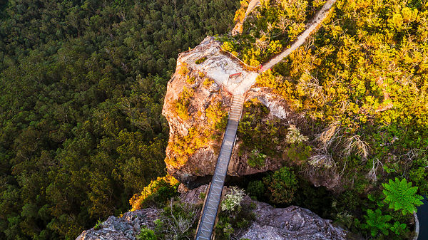 14m steel bridge across the deep rock chasm on the edge of the sandstone escarpment cliff faces.   It  connects to scenic loo...