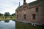 Henry Bedingfeld feed swans at Oxburgh Hall