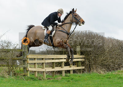 Jimmy Couldrey jumping a hunt jump on the Quenby Estate