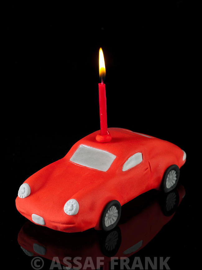 Car birthday cake with a candle