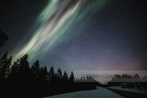 Aurora above the road in Finnish Lapland