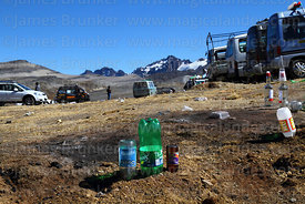 Upturned bottles left in the ground as offerings to Pachamama, La Cumbre, Cordillera Real, Bolivia