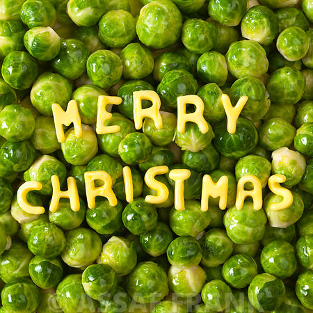 Merry christmas text on bed of burssle sprouts