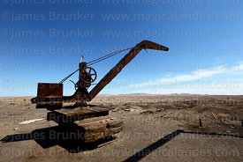 Rusting crane in the abandoned nitrate mining town of Humberstone, Region I, Chile